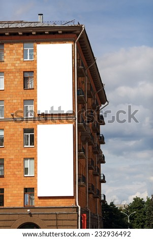 Two blank vertical billboards on the wall of a brick house. Clipping path. - stock photo