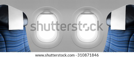 Two blank windows plane with blue seats - stock photo