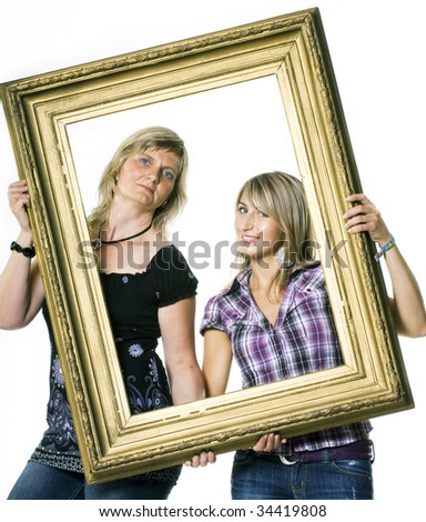 Two blonde woman holding a wooden frame