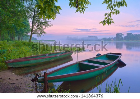 Two boats on Narew river. Sunrise landscape. - stock photo