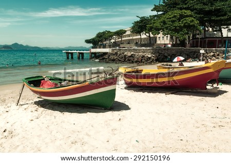 Two boats on the Copacabana beach and Fort of Copacabana in Rio de Janeiro. Brazil - stock photo