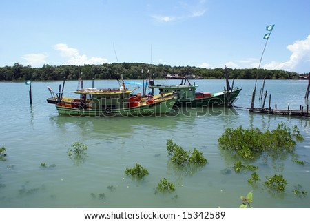 Two boats on the river in Kemaman, East Malaysia - stock photo