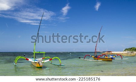 two boats ready to sail in sanur bali during a summer day - stock photo