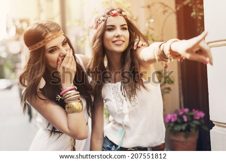 Two boho girls have fun in summer day - stock photo