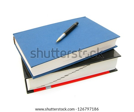 Two books and black pen on white background or back to school - stock photo