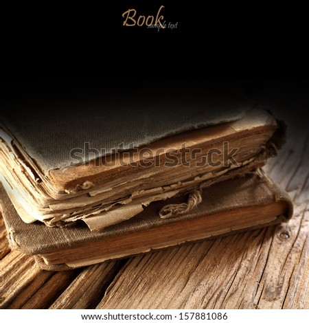 two books and wooden desk  - stock photo