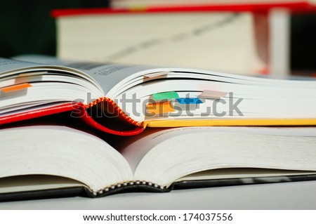 Two books are opened and piled together - stock photo