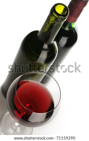 Two bottles and glass of red wine on white background. - stock photo