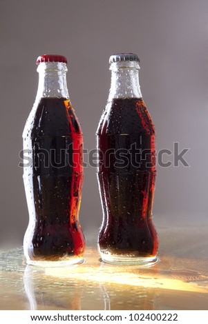 two bottles of cold cola with water drops. Isolated on white - stock photo