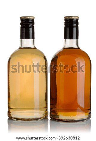 two bottles of liquor on a white background - stock photo