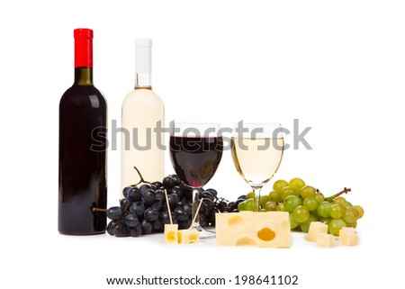 Two bottles of white and red wine, two glasses and grapes isolated on white background