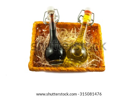 Two bottles of wine vinegar and olive oil in a gift box isolated on white background - stock photo