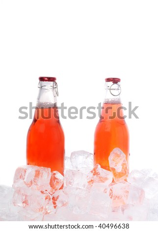 two bottles with  drink in ice