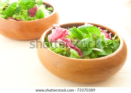 Two bowls of fresh salad