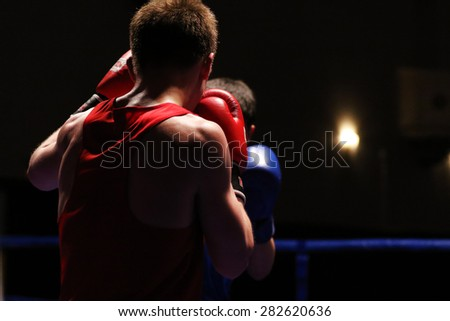 Two boxers during the fight - stock photo