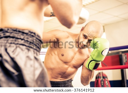 Two boxers training and making sparring - stock photo
