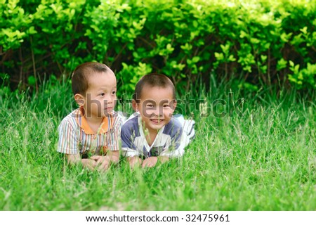 Two boy play on grass