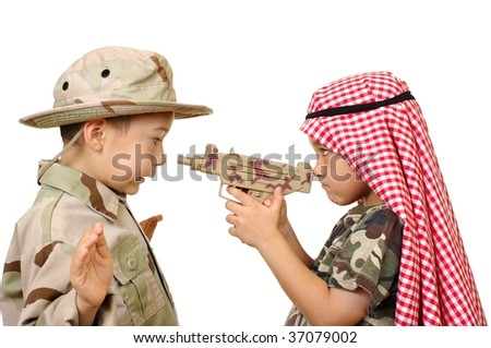 Two boys, ages six and seven years, playing war, isolated on white background