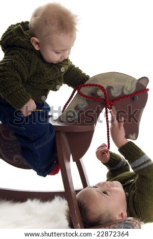 two boys and rocking horse - stock photo