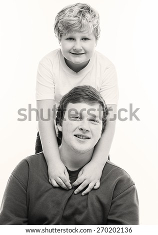 Two boys brothers Jr and senior together fat black and white - stock photo