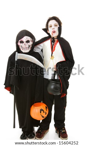 Two boys dressed as monsters for Halloween.  Full body isolated on white. - stock photo