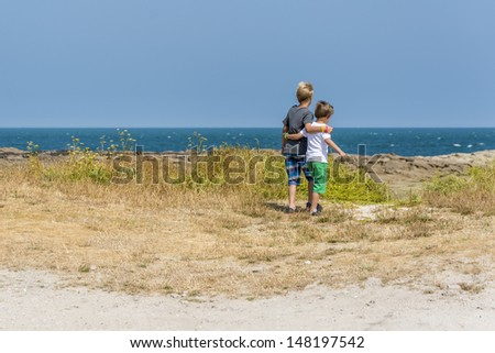 two boys having a beautiful day at the beach - stock photo