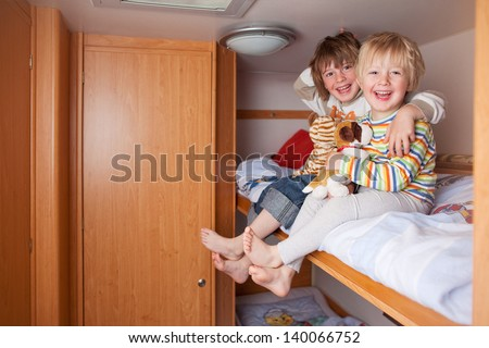 Two Boys In A Caravan - stock photo