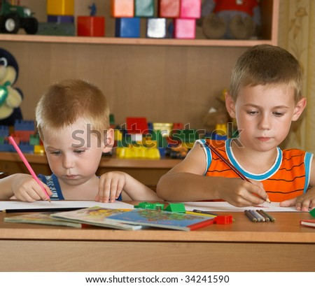 two boys in a children's room - stock photo