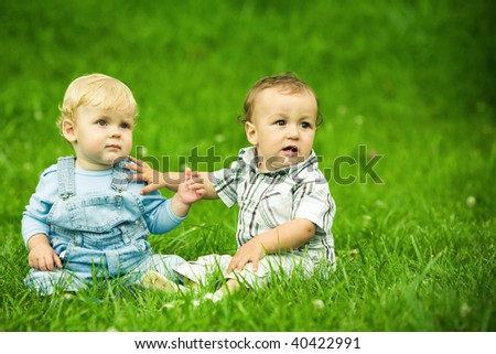 two boys on the grass