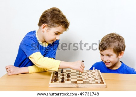 Two Boys playing chess - stock photo