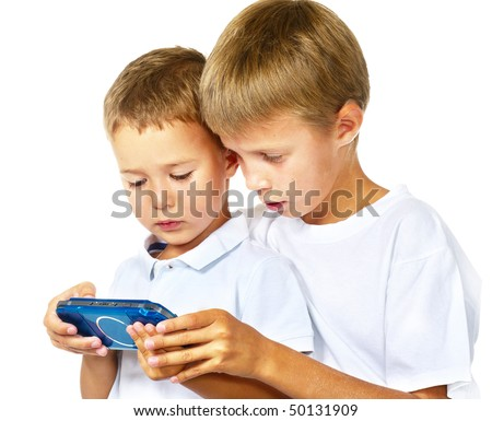 two boys playing handheld game console over white - stock photo