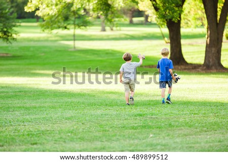 Two boys playing in park.