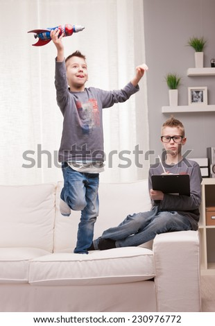 two boys playng as scientists and rocket inventors - stock photo
