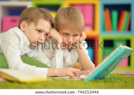 Two boys reading