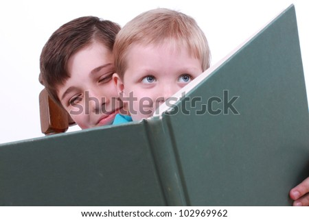 Two boys reading a book - stock photo