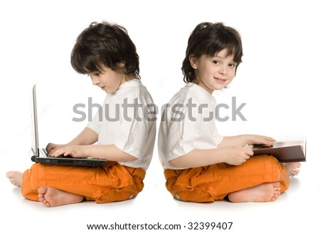 Two boys (reflecnbon) - one wish laptop, other reading