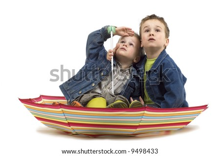 Two boys sitting in an umbrella, like it's a boat. They're watching if the storm is coming.
