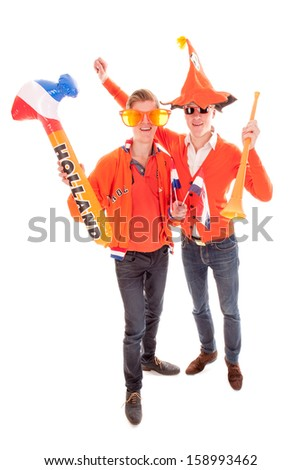 two boys, the supporters of the dutch soccerteam. - stock photo