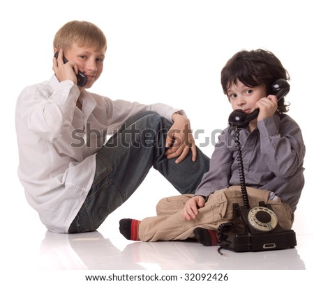 Two boys with a telephone - stock photo