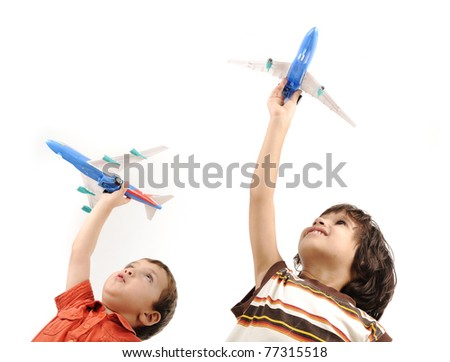 Two boys with airplanes in hands - stock photo
