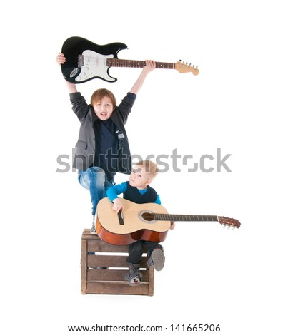 two boys with guitars on a box over white background - stock photo