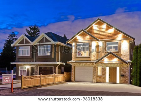 Two brand new houses for sale   in suburbs at dusk in Vancouver, Canada