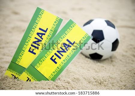 Two Brazil Final Tickets Football Soccer Ball Beach - stock photo