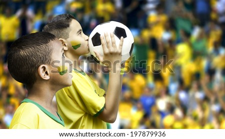 Two brazilian fans on the stadium - stock photo