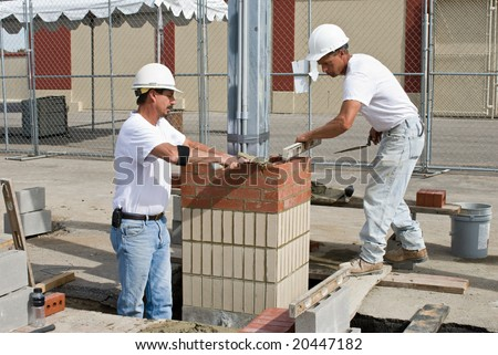 Two Bricklayers - stock photo