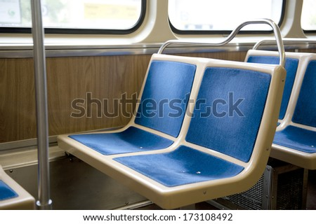 Two, bright, blue, sewn, bus seats made up of four squares. - stock photo