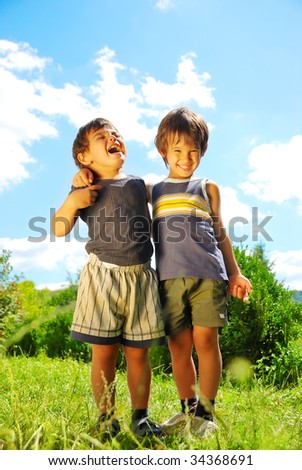 Two brother huging each other outdoor - stock photo