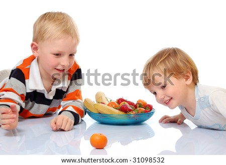 two brothers and plate of fruits isolated on white