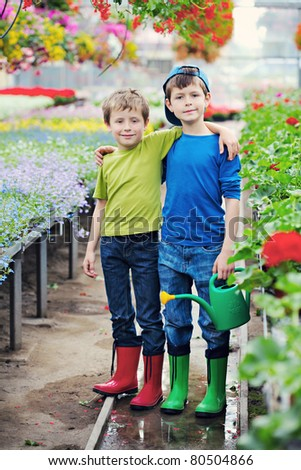 two brothers as a gardeners - kids and family