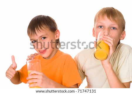 two brothers drink juice on a white